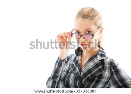 Attractive businesswoman in a plaid shirt and glasses - stock photo