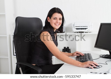 attractive businesswoman in office - stock photo