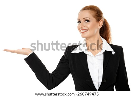 Attractive businesswoman in suit presenting an invisible product - stock photo