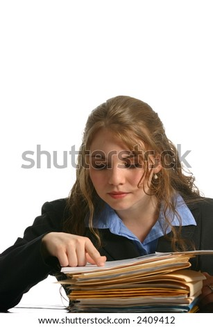 attractive businesswoman looking at files - stock photo