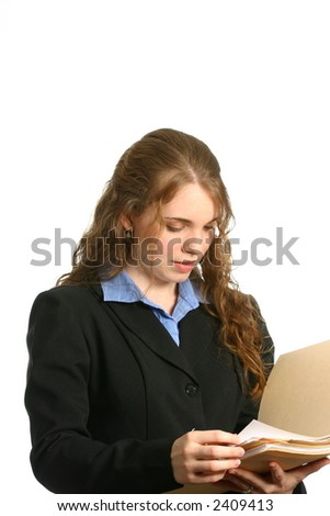 attractive businesswoman looking at files in folder - stock photo