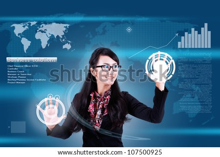 Attractive businesswoman navigating futuristic interface (outstanding business people in interiors / interfaces series) - stock photo