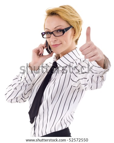 attractive businesswoman on the phone making her ok sign - stock photo