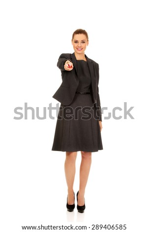 Attractive businesswoman pointing on you with pencil.  - stock photo