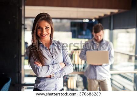 Attractive businesswoman posing - stock photo