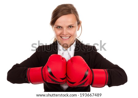 Attractive businesswoman punching red boxing gloves together ready to fight  isolated on white background. - stock photo
