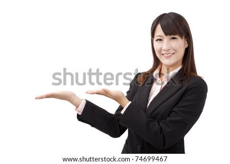 Attractive businesswoman  shows your product - stock photo