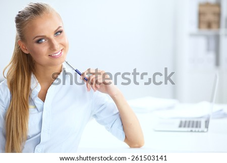 Attractive businesswoman sitting in the office . - stock photo