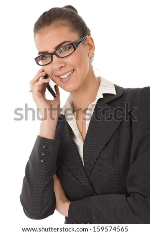 Attractive businesswoman smiling, talking on mobile phone, isolated on white.