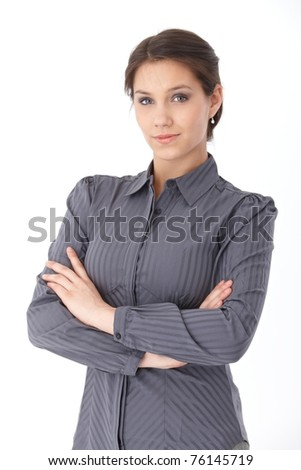 Attractive businesswoman standing arms crossed, looking at camera.? - stock photo