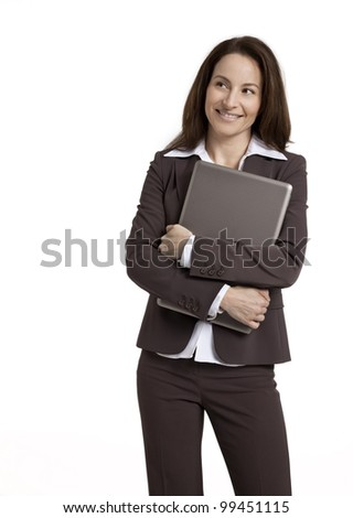 Attractive businesswoman standing, holding laptop computer, isolated on white. - stock photo