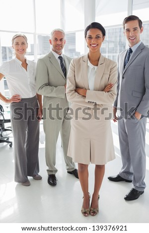 Attractive businesswoman standing in front of colleagues in the meeting room - stock photo