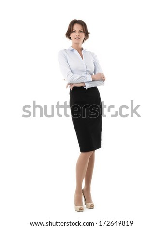 Attractive businesswoman standing, with her arms crossed, against on white background. - stock photo