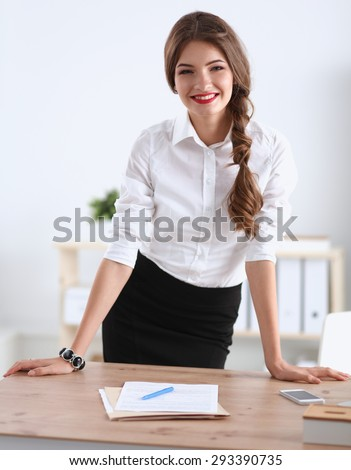 Attractive businesswoman stnding