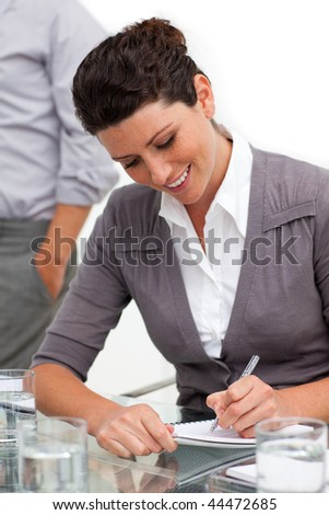 Attractive businesswoman taking notes in a meeting