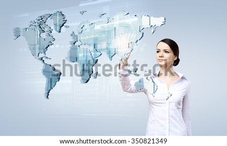 Attractive businesswoman touching map on media screen with finger