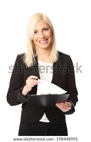 Attractive businesswoman wearing a suit and shirt, holding a clipboard. White background. - stock photo