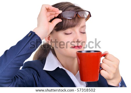 Attractive businesswoman with a cup of coffee - stock photo