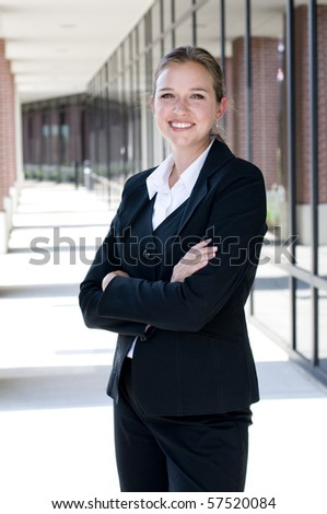 Attractive businesswoman with arms crossed and smiling