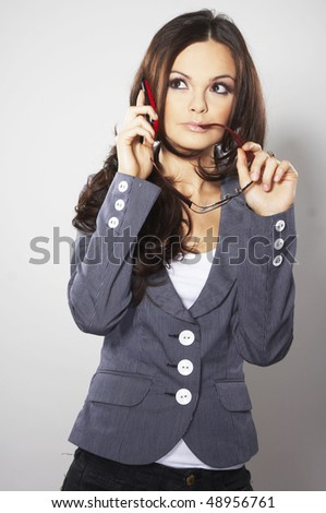 Attractive businesswoman with cell phone and eye glasses - stock photo