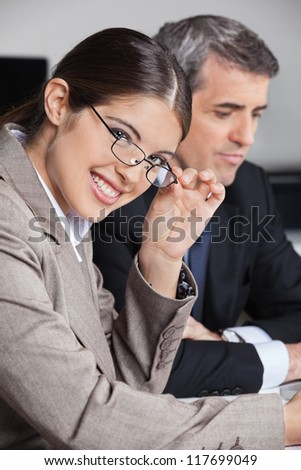 Attractive businesswoman with glasses in a business meeting in the office - stock photo