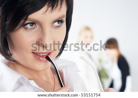 Attractive businesswoman with glasses in office