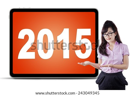 Attractive businesswoman with hands gesture showing numbers 2015 on a board - stock photo