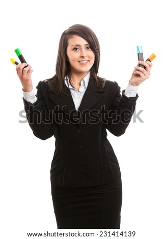 Attractive businesswoman with highlighters in her hands - stock photo
