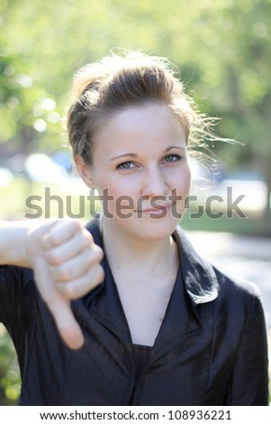 Attractive Businesswoman with Thumbs Down - stock photo