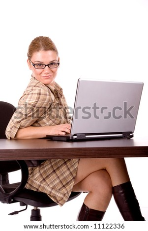 Attractive businesswoman working by laptop. - stock photo