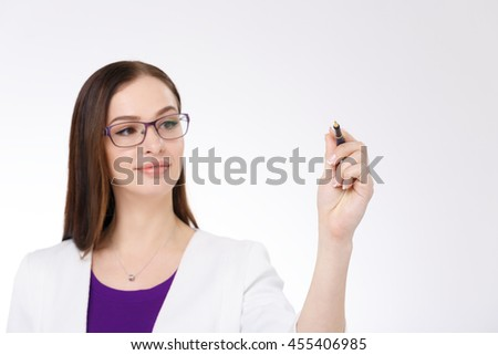 Attractive businesswoman writing with pen on white background - stock photo
