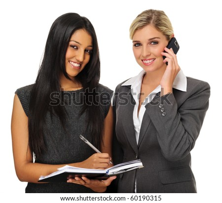 Attractive businesswomen planning their meeting with organiser and phone - stock photo