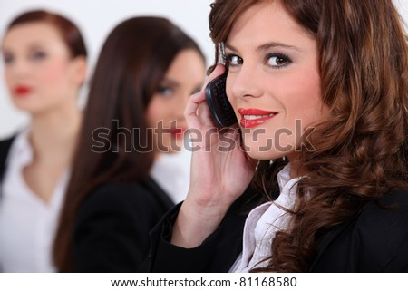 Attractive businesswomen with a cellphone - stock photo