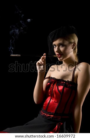 Attractive cabaret girl smoking a cigarette with an extension - stock photo
