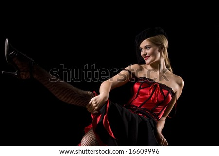 Attractive cabaret with net over her face kicking and showing her stockings - stock photo