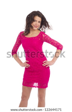 Attractive carefree young lady dressing pink dress posing on white background - stock photo