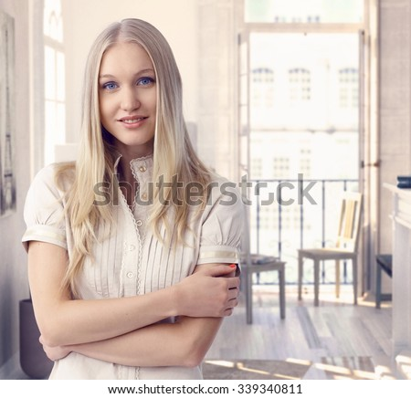 Attractive casual caucasian blue eyed romantic blonde woman at vintage hotel room in Paris. Smiling, daydreaming, standing arms crossed. - stock photo