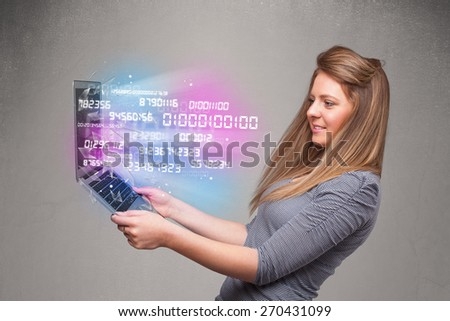 Attractive casual woman holding laptop with exploding data and numers - stock photo