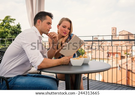 Attractive casual young at the restaurant in hotel terrace.  - stock photo