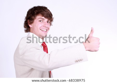 Attractive caucasian boy showing thumbs up. Image isolated on black background - stock photo