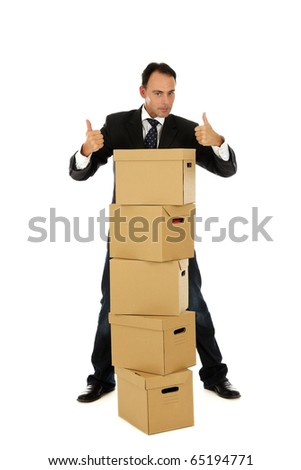 Attractive caucasian businessman in office behind the storage boxes with the thumbs up . Studio shot. White background. - stock photo