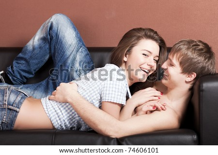 attractive caucasian couple hugs in room - stock photo