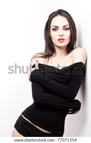 attractive caucasian female posing in studio isolated on white - stock photo