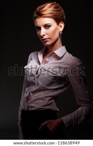 attractive caucasian female posing over dark background - stock photo
