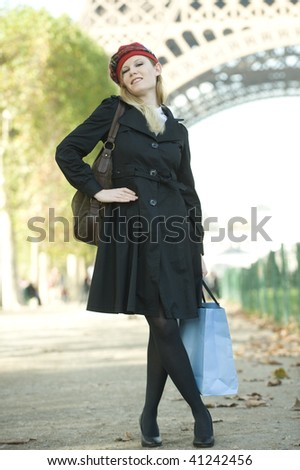 Attractive Caucasian female tourist in Paris. Vertically framed shot. - stock photo