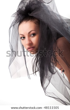 Attractive caucasian female with black veil portrait - stock photo