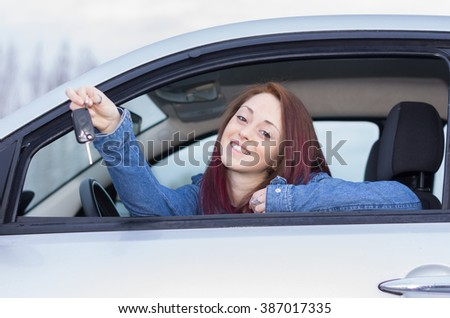 Attractive caucasian girl holding her keys car - stock photo