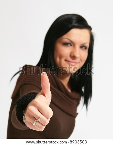 Attractive caucasian girl showing thumbs up with happy smiling facial expression. Image isolated on white background. - stock photo
