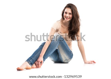 Attractive caucasian girl sitting on floor - stock photo