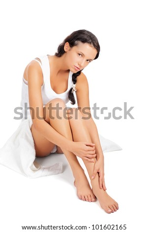 Attractive caucasian girl sitting on floor , Isolated on white background. - stock photo